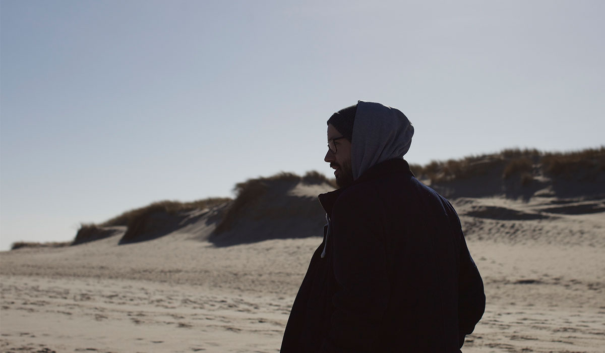 Photo of Sebastian Waters on the beach; Photo taken by Ailine Liefeld